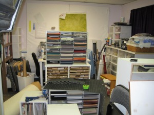 Paper Crafting supplies piled on the sewing side of the studio